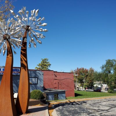 The Dandeblome sculpture on Main Street in Blue Springs.