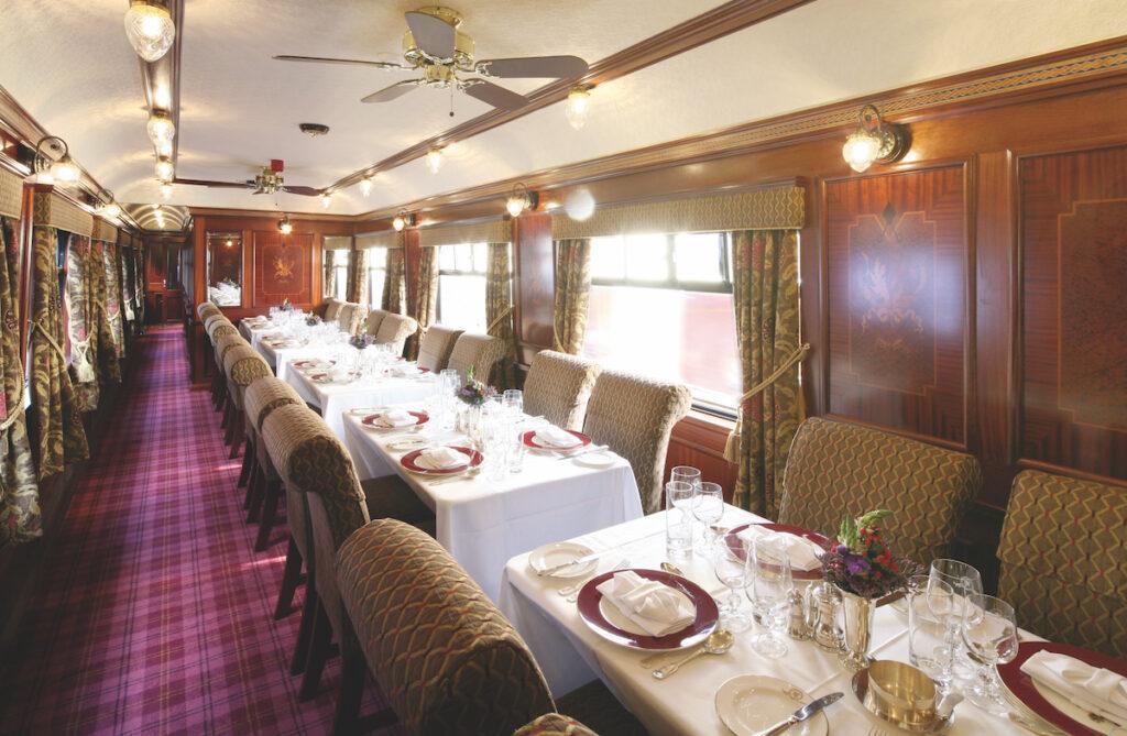 The dining car of the Belmond Royal Scotsman train.