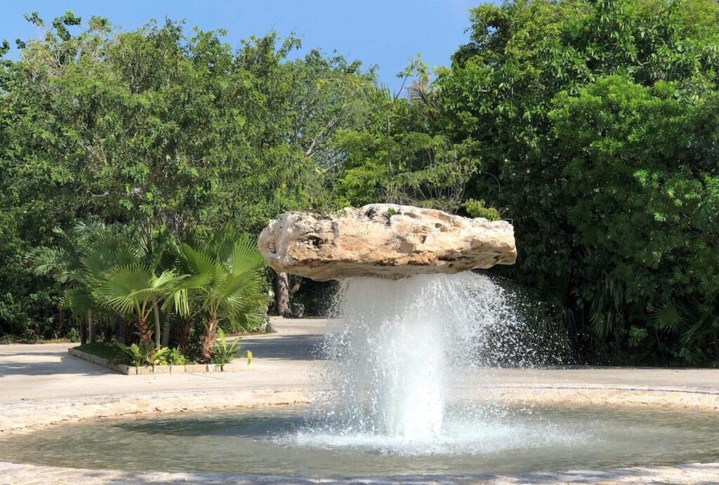 The enormous boulder fountain at the entrance to Xenses.