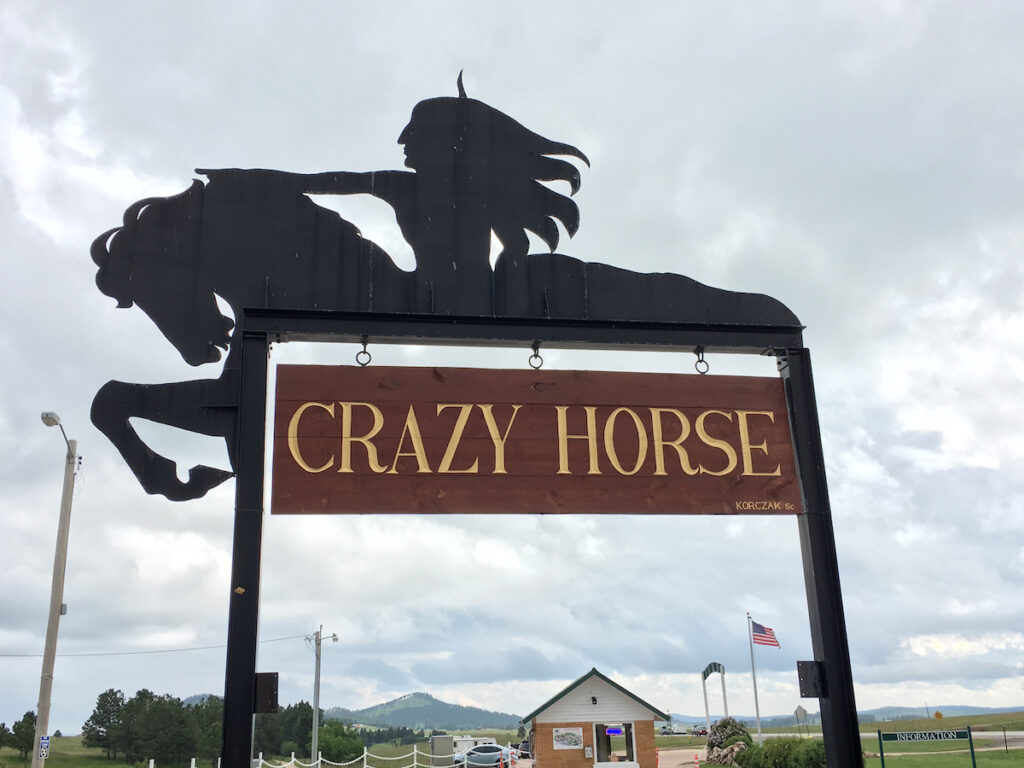 The entrance to the Crazy Horse Memorial parking lot.