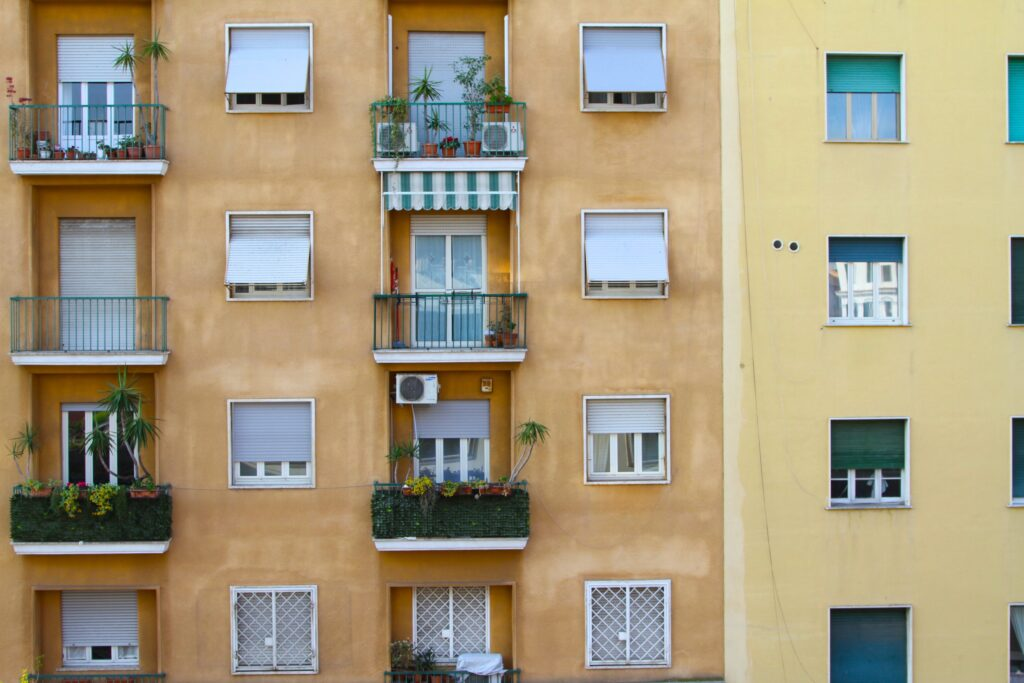 The facade of an orange and yellow italian building