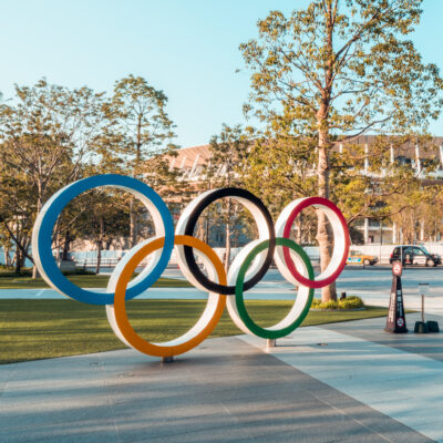 The five-ring symbol of the Olympic Games and view of the New National Stadium