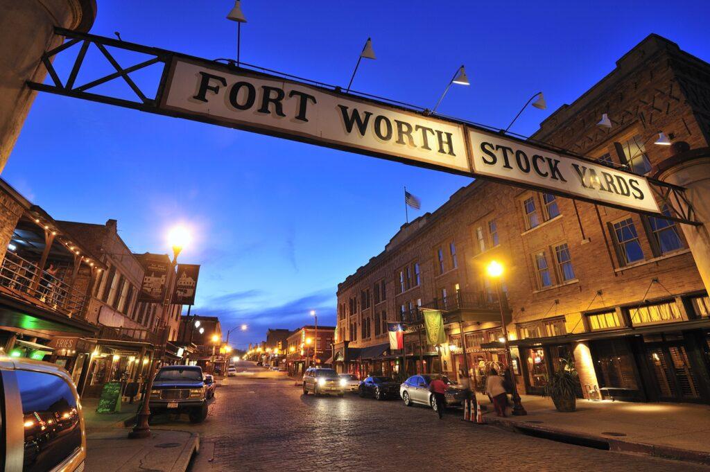 The Fort Worth Stockyards at night.