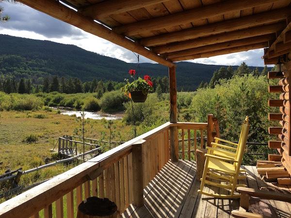 The front porch of a cabin at Rawah Ranch.