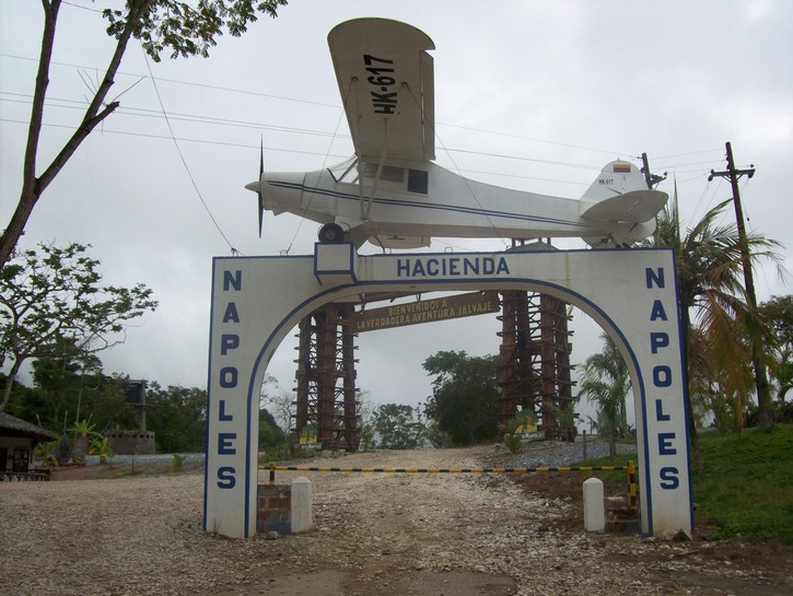 The gate to Hacienda Nápoles, with a model of Pablo Escobar's old plane.