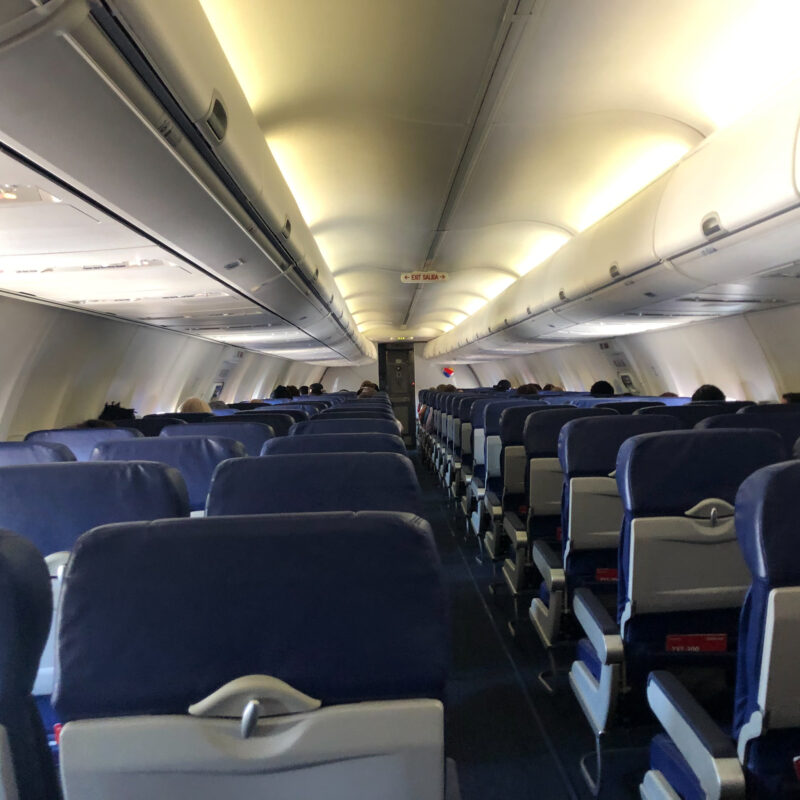 The half-empty airplane ride the writer took on her trip.