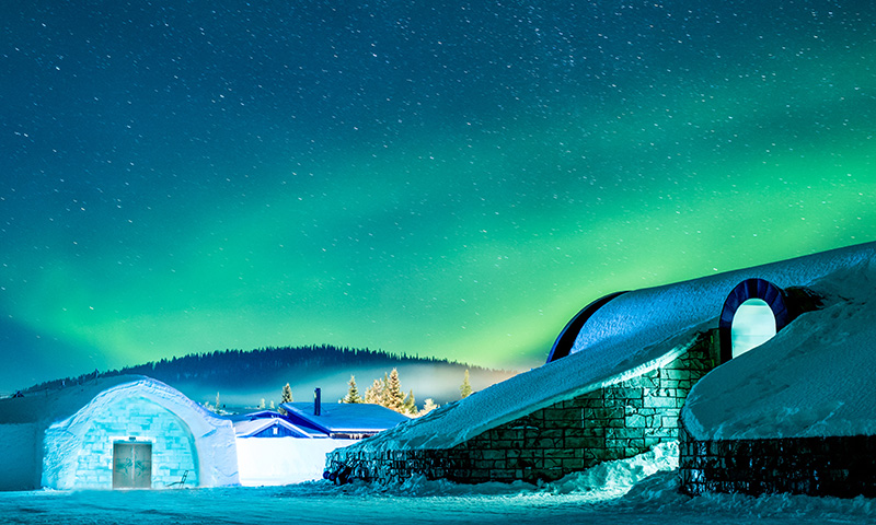 The Icehotel in Sweden underneath the Northern lights.