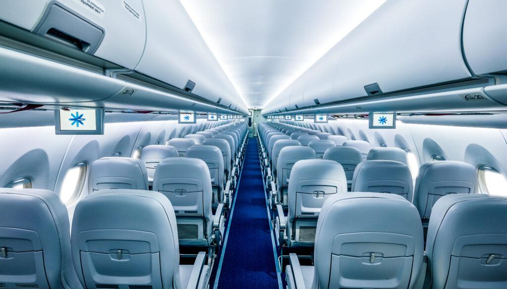 The interior of a SuperJet International flight.