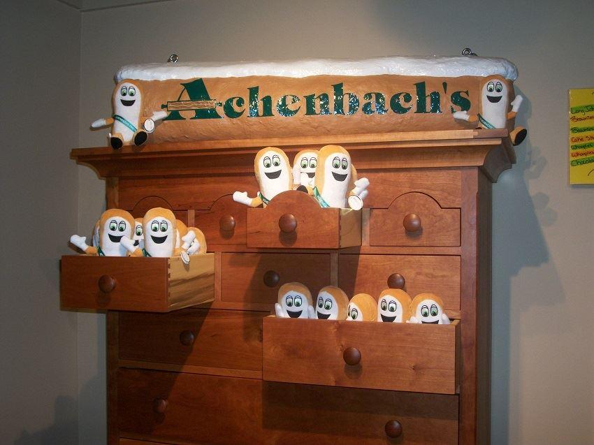 The Long John Cake mascot of Achenbach's Pastries.