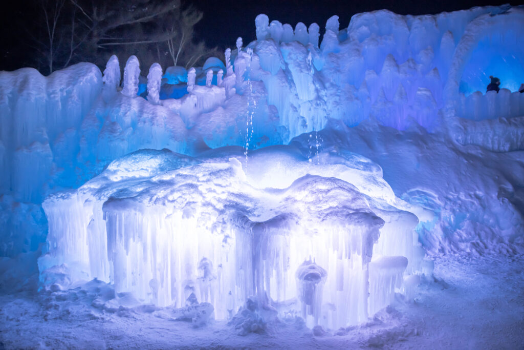 The New Hampshire Ice Caves lit up at night.