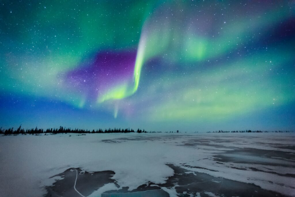 The Northern Lights over a frozen lake in Churchill.