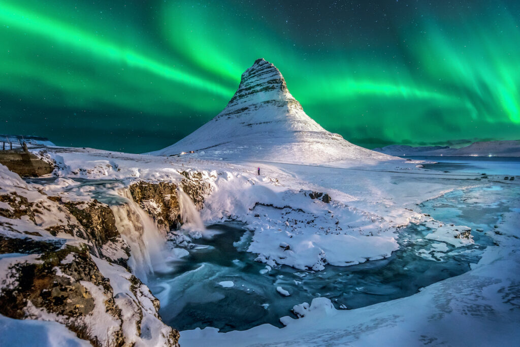 The Northern Lights over Kirkjufell in Iceland.