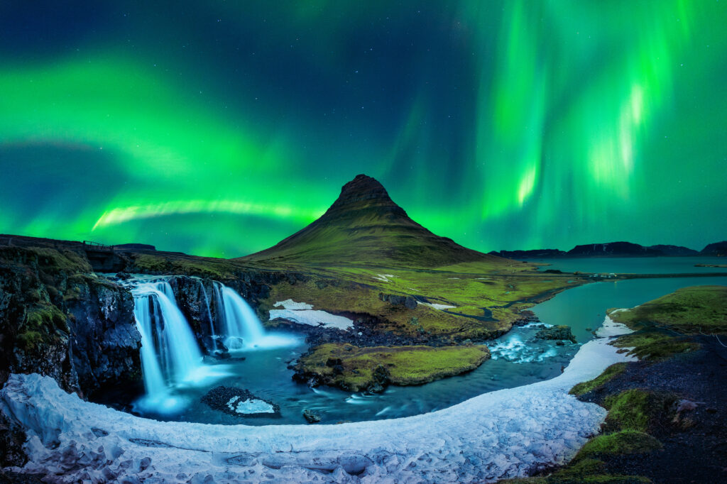 The northern lights over Kirkjufell mountain in Iceland.