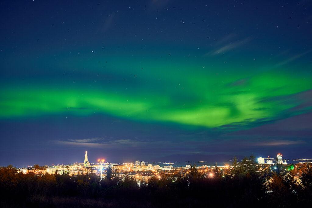 The Northern Lights over Reykjavik, Iceland.
