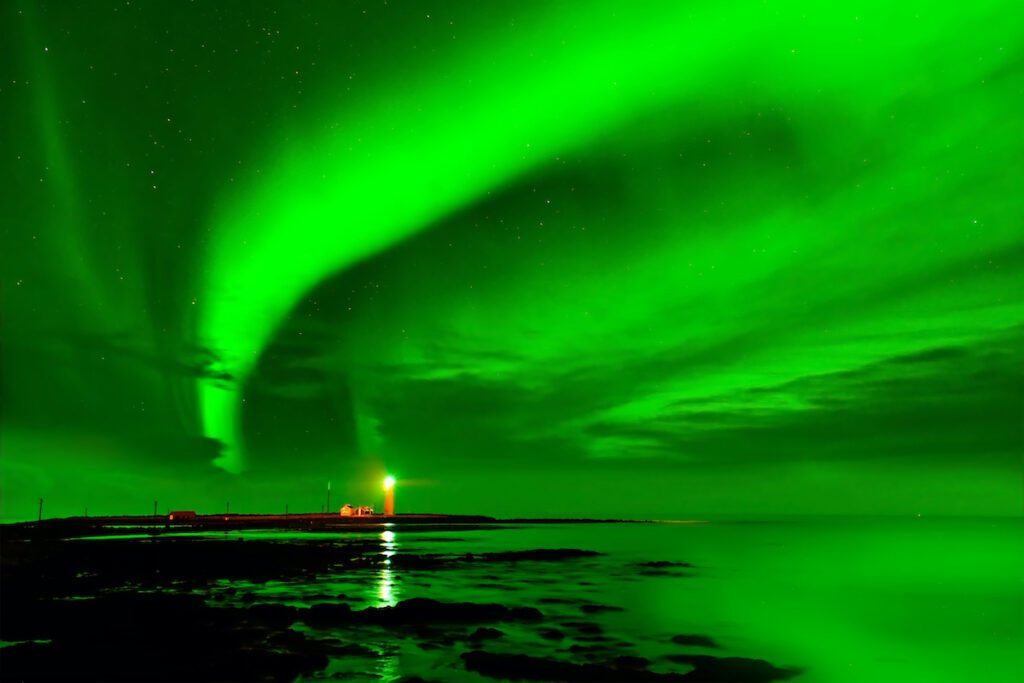The Northern Lights over the Grotta Lighthouse in Iceland.