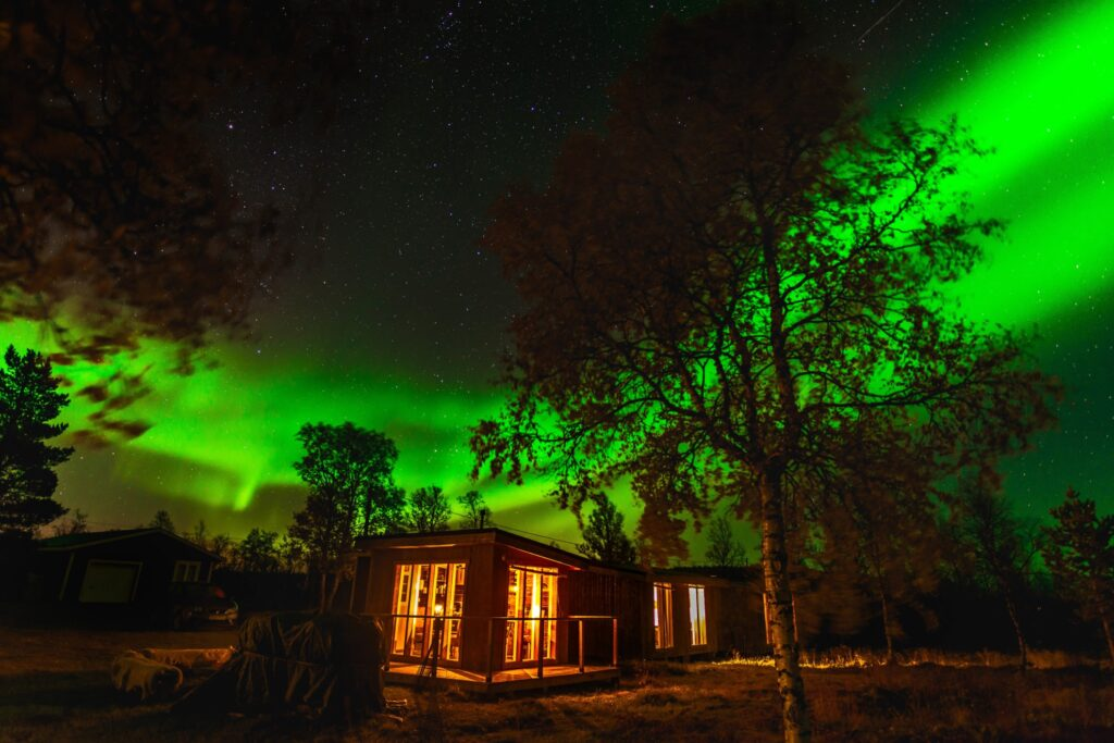 The Northern Lights over the Arctic Gourmet Cabins.
