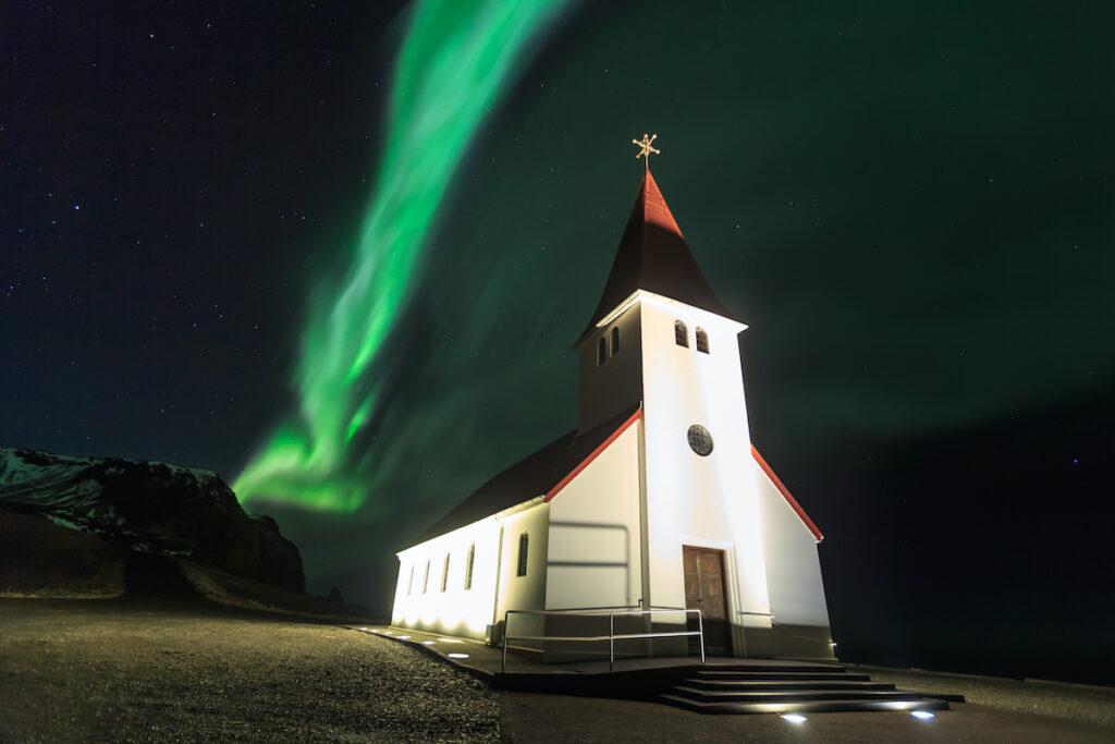 The Northern Lights over Vik I Myrdal Church in Iceland.