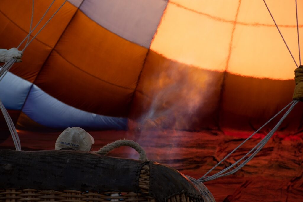 The pilot inflating the balloon.