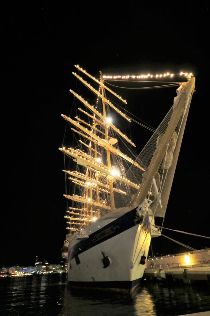 The Royal Clipper lit up at night.