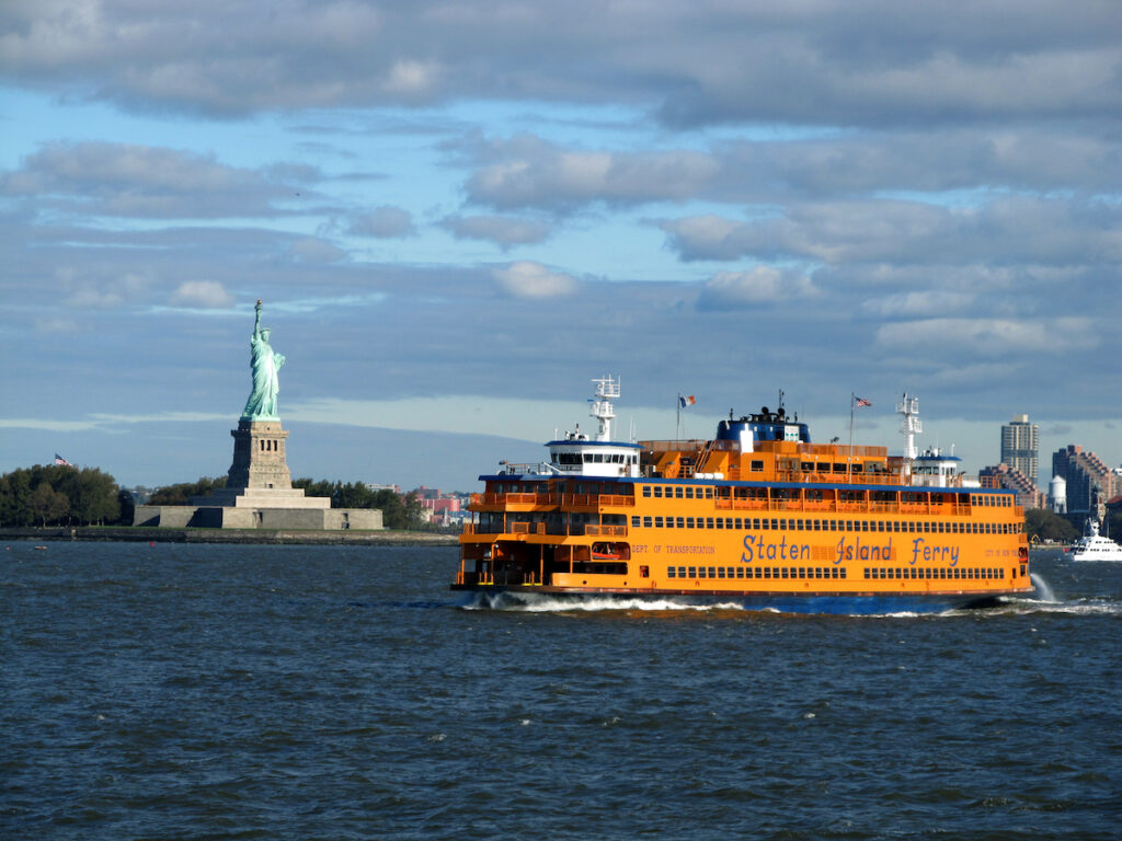 The Staten Island Ferry near the Statue of Liberty.