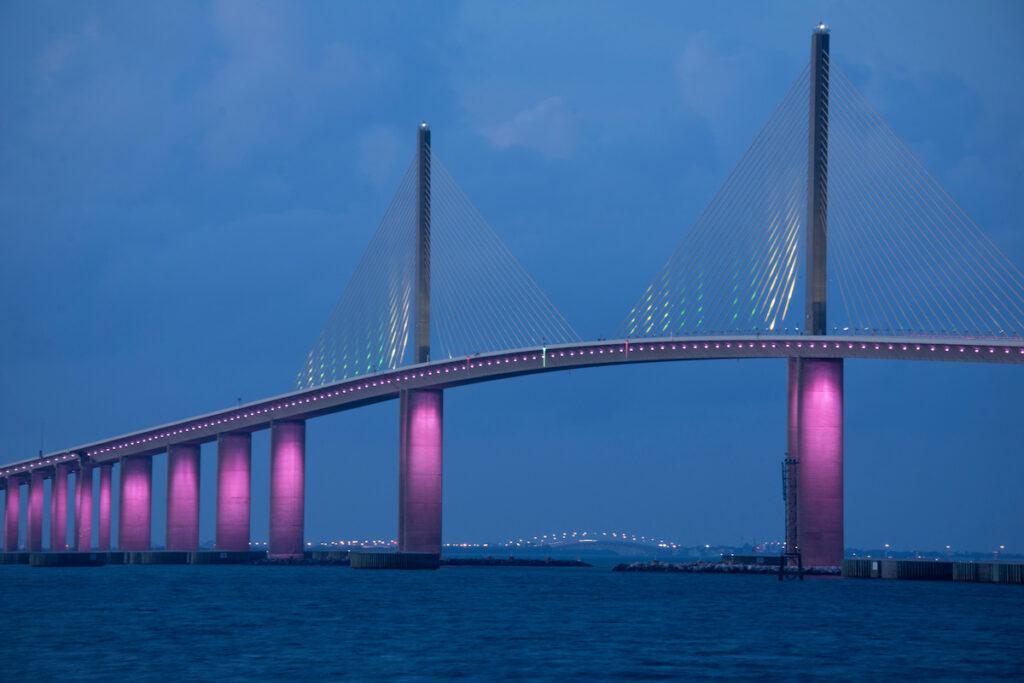 The Sunshine Skyway bridge in Florida lit up in pink.