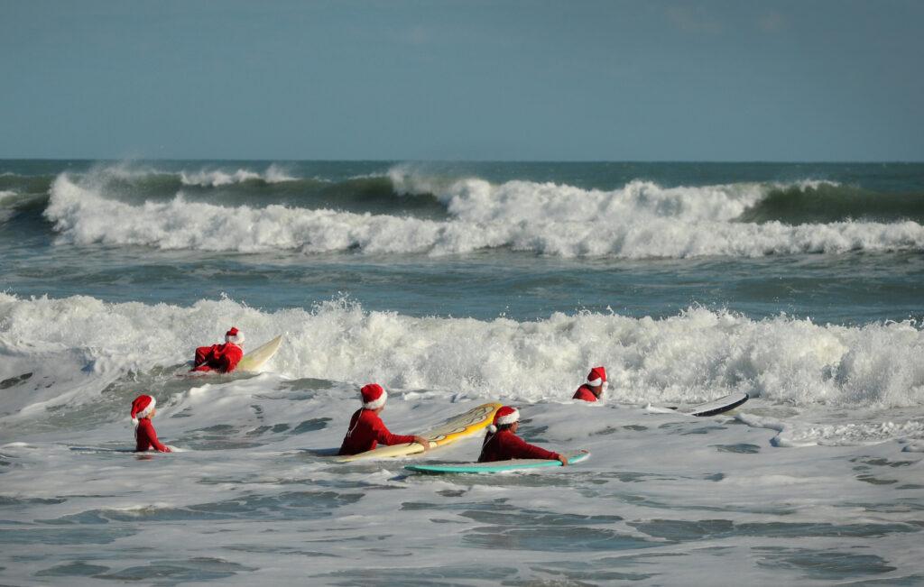 The Surfing Santas on Cocoa Beach.