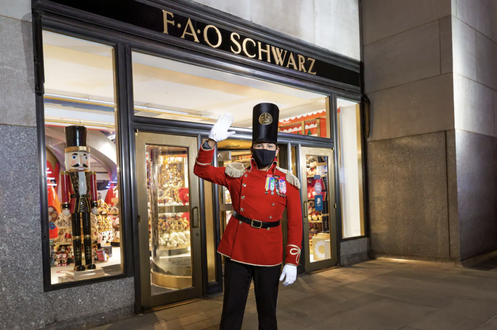 The toy soldier host at the FAO Schwarz Airbnb in New York City.