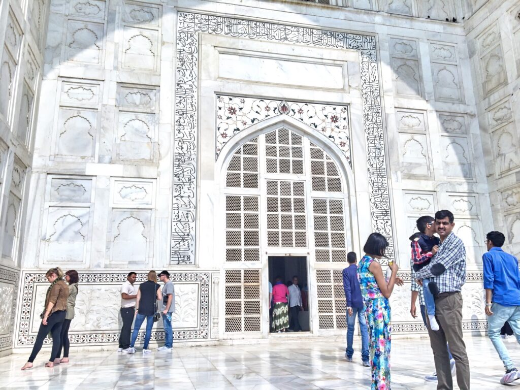 The white marble entrance of the Taj Mahal