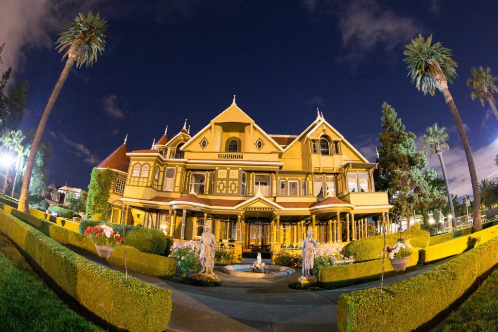 The Winchester Mystery House at night.