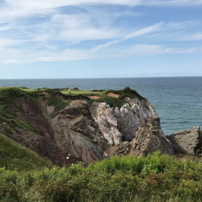 The world renowned pat 3, 16th hole at Cabot Cliffs.