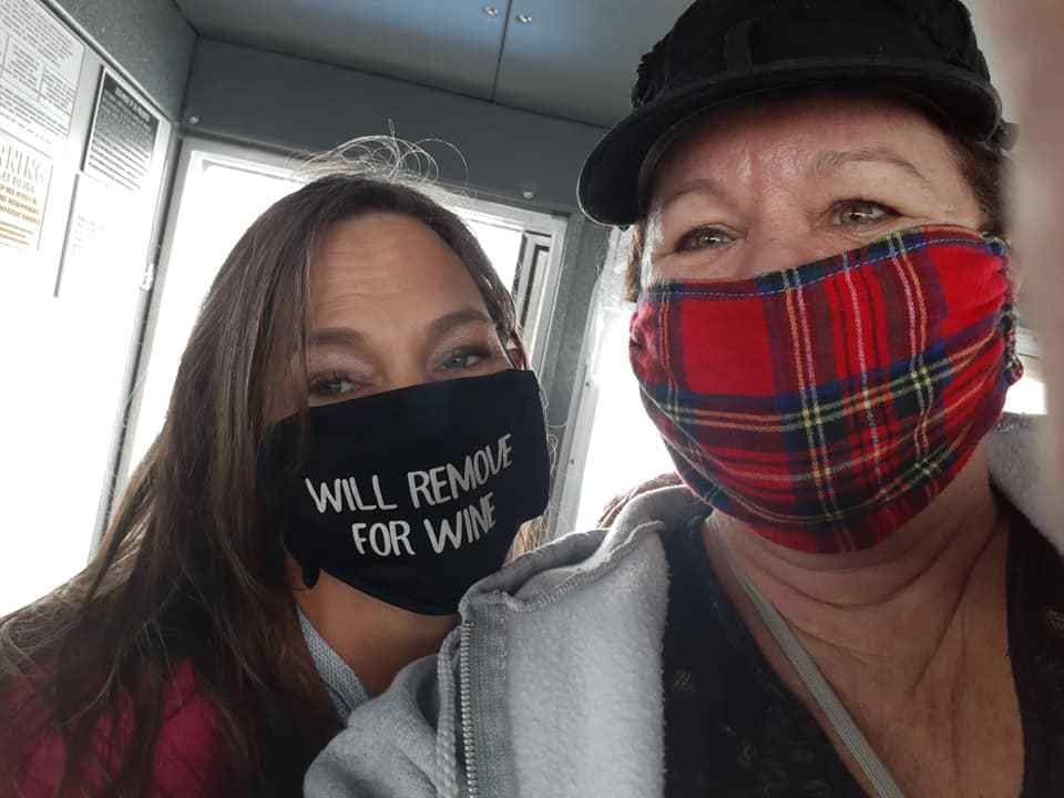 The writer and a fellow traveler wearing masks on their trip.