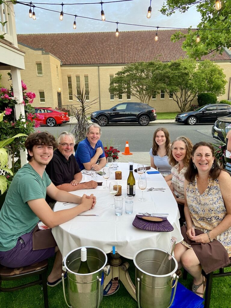 The writer and her family dining out on vacation.