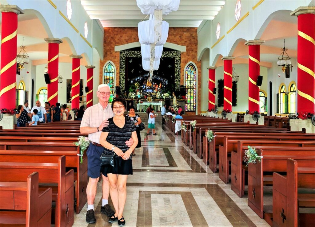 The writer and her husband at a church in Cozumel.