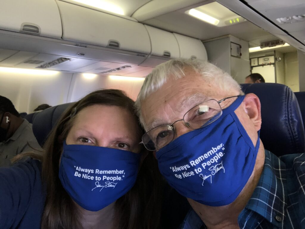 The writer and her husband wearing masks.