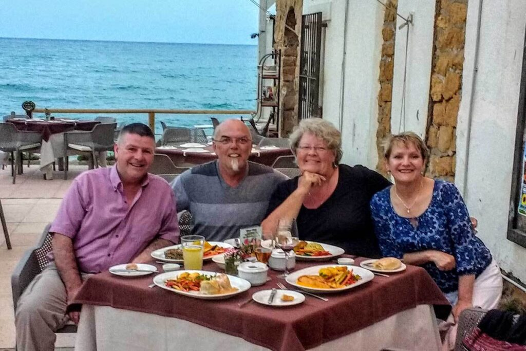 The writer and her husband with friends in Spain.