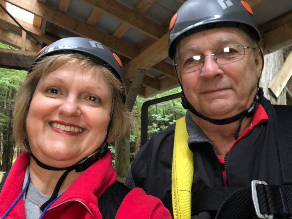 The writer and her husband zip-lining.