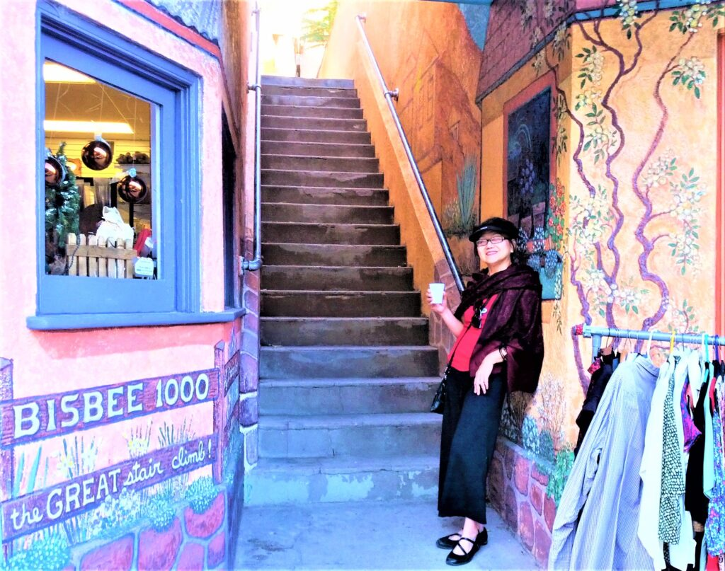 The writer at the foot of a staircase in Old Bisbee.