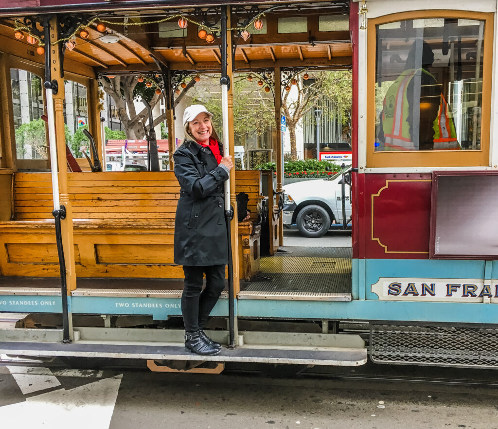 The writer boarding a cable car in San Francisco.