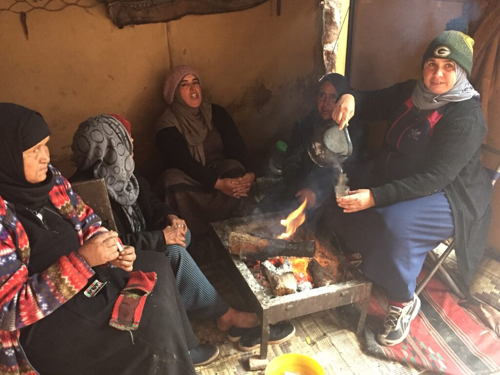 The writer having tea at a Bedouin camp in Petra.