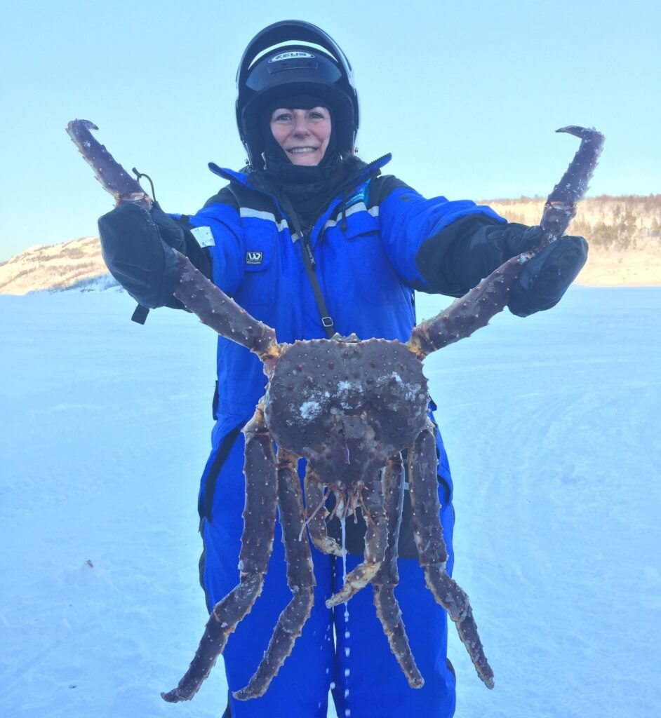 The writer holding a giant crab.