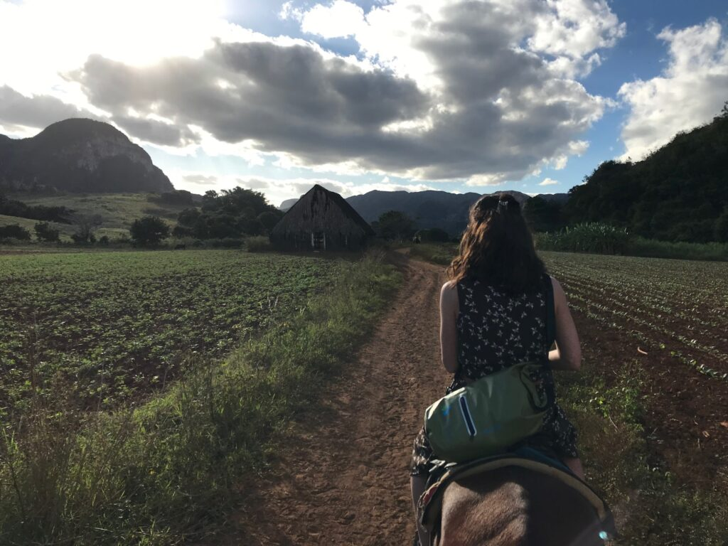 The writer horseback riding in Vinales Valley.