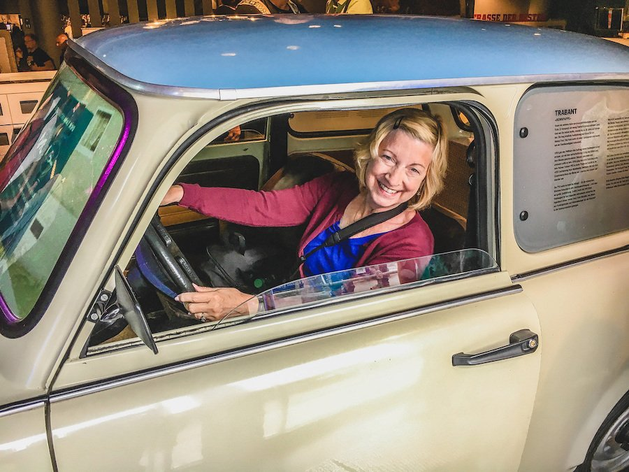 The writer in a Trabant car at the DDR Museum.