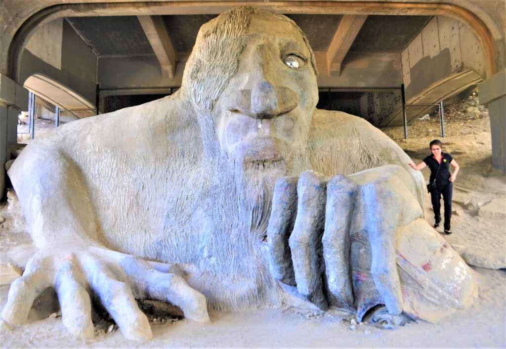 The writer next to the Fremont Troll in Seattle.