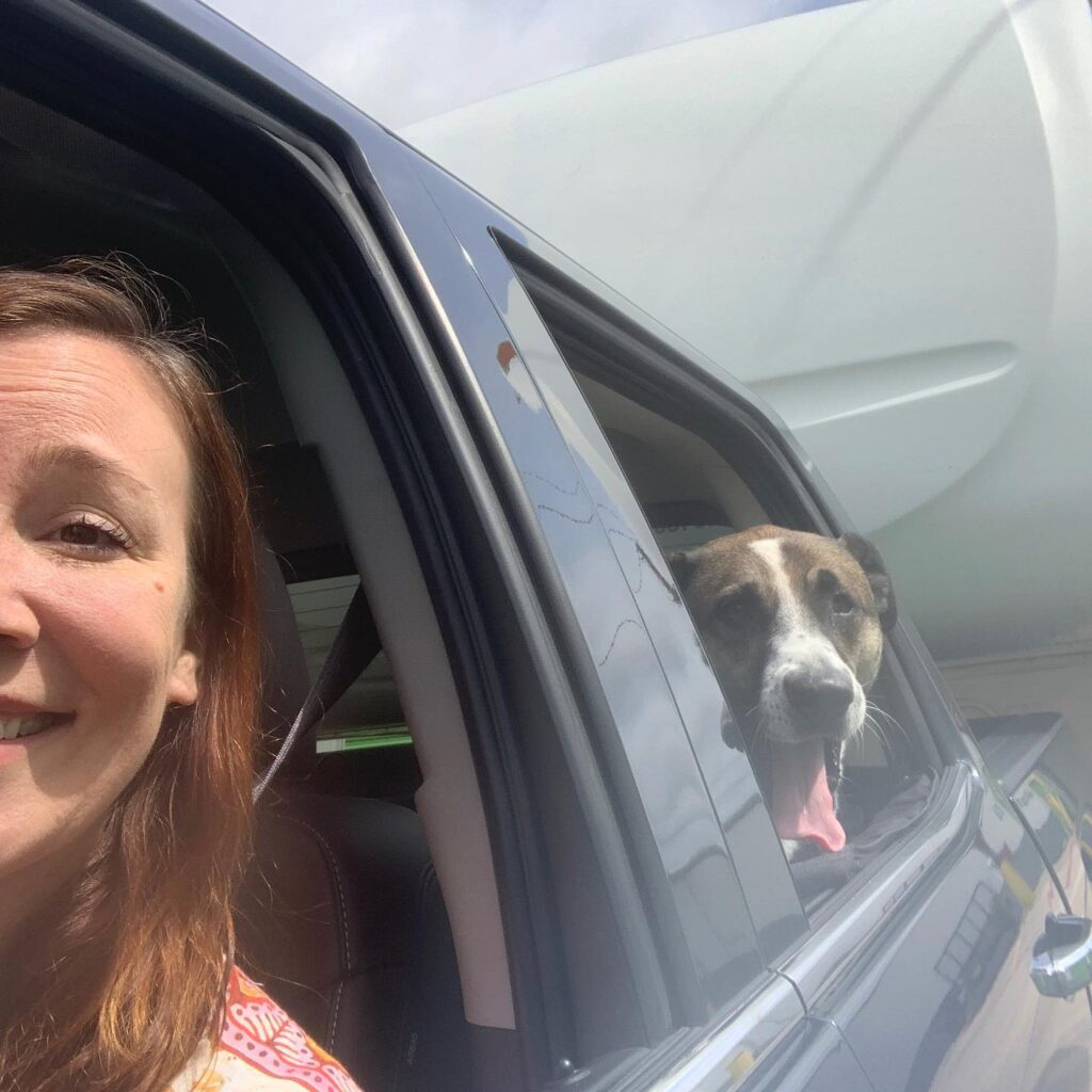 The writer on n RV trip with her dog.