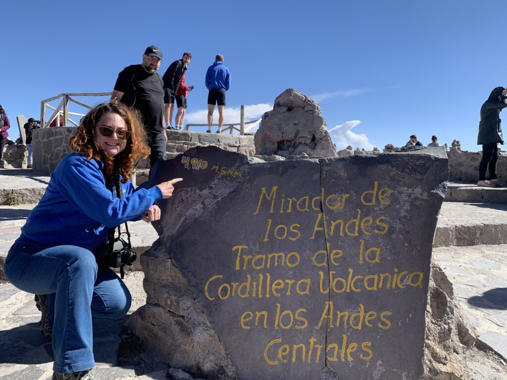 The writer posing with an altitude marker.