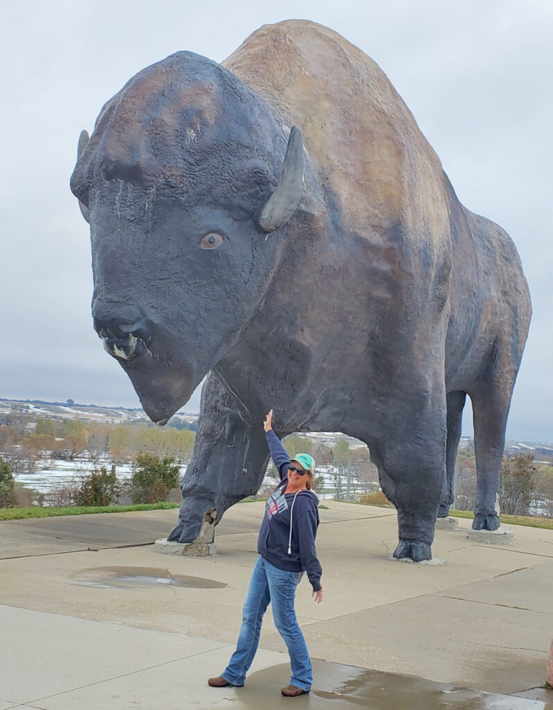 The writer posing with the World's Largest Buffalo.