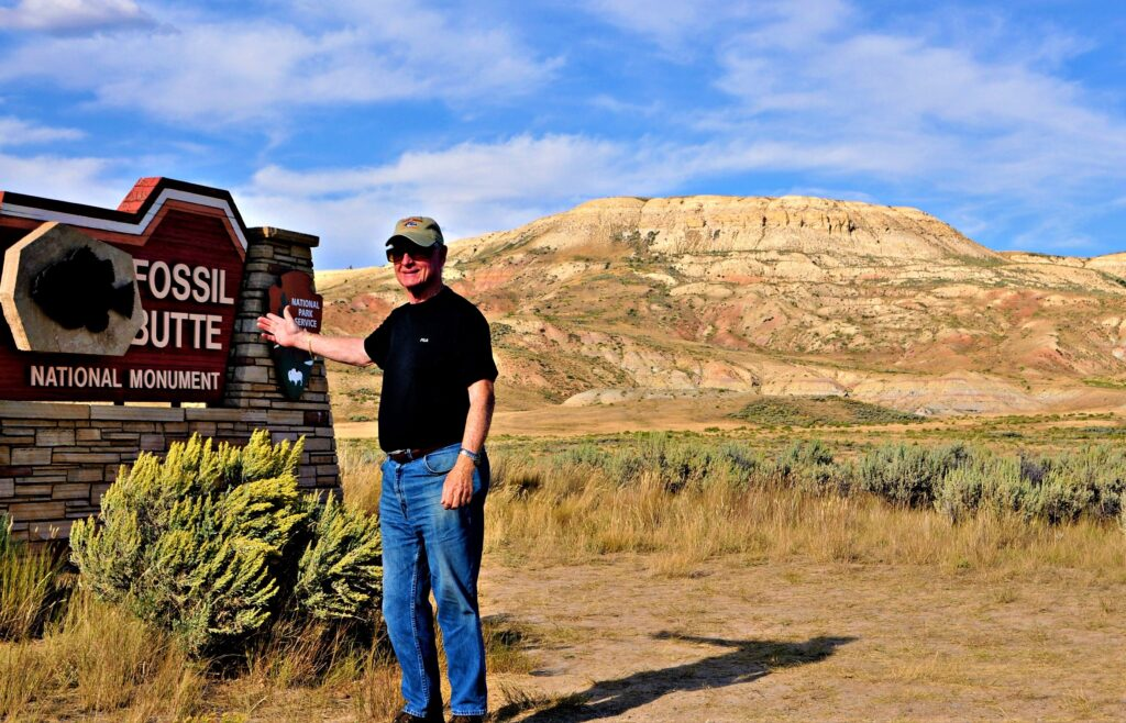 The writer's husband at the entrance to Fossil Butte National Monument.