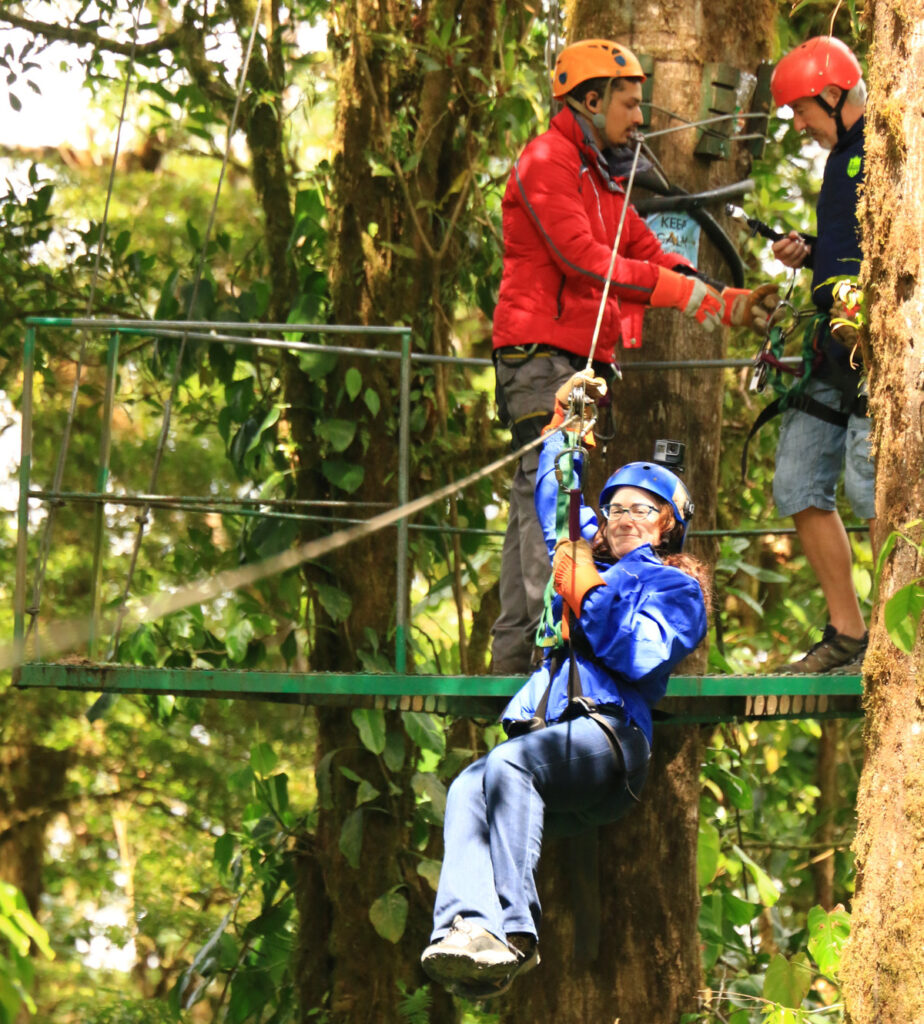 The writer smiling before experiencing the zip line.