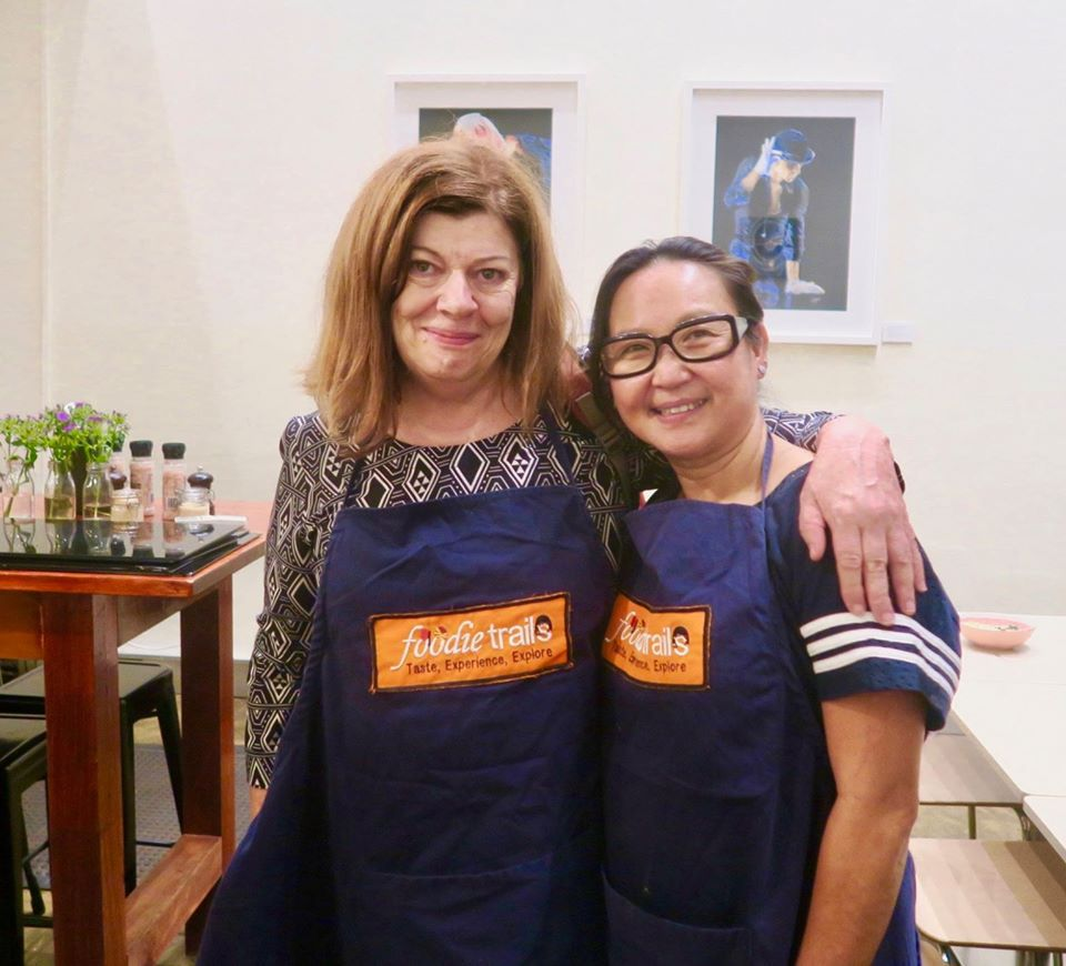 The writer taking a cooking class in Thailand.