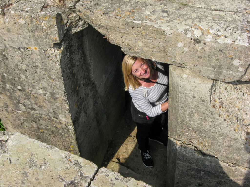The writer touring the bunkers at Pointe Du Hoc.